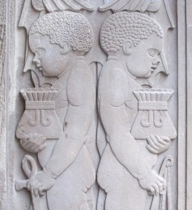Carving of two black children at the entrance to Martin's Bank, Liverpool