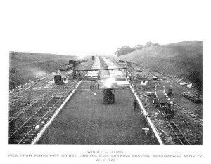 Black and white photo looking along the length of the East Lancashire Road as it was being built